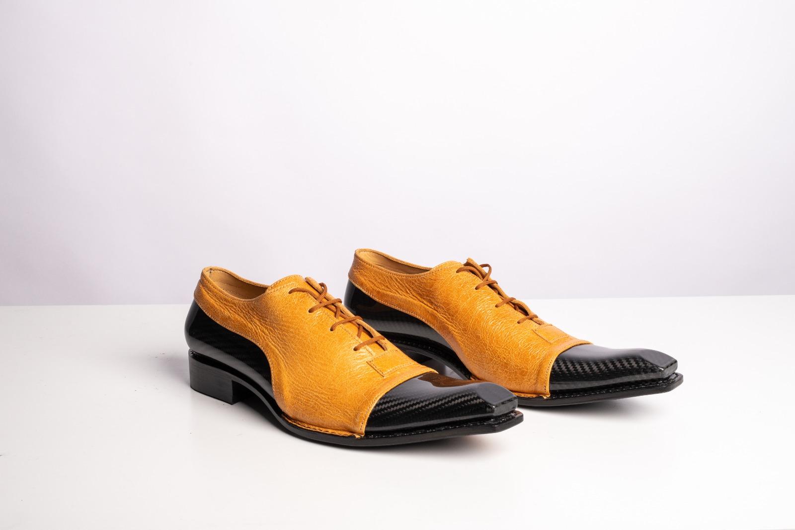 scarpe in pelle e fibra di carbonio